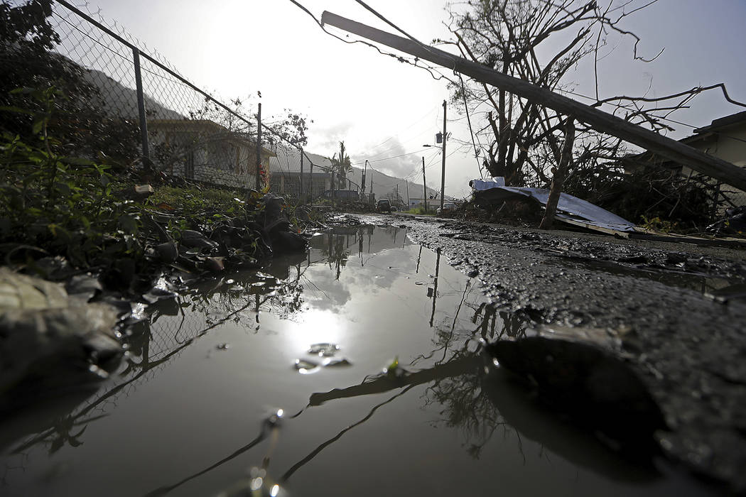 Downed power lines and debris are seen in the aftermath of Hurricane Maria in Yabucoa, Puerto Rico, Tuesday, Sept. 26, 2017. Gov. Ricardo Rossello and Resident Commissioner Jennifer Gonzalez, the  ...