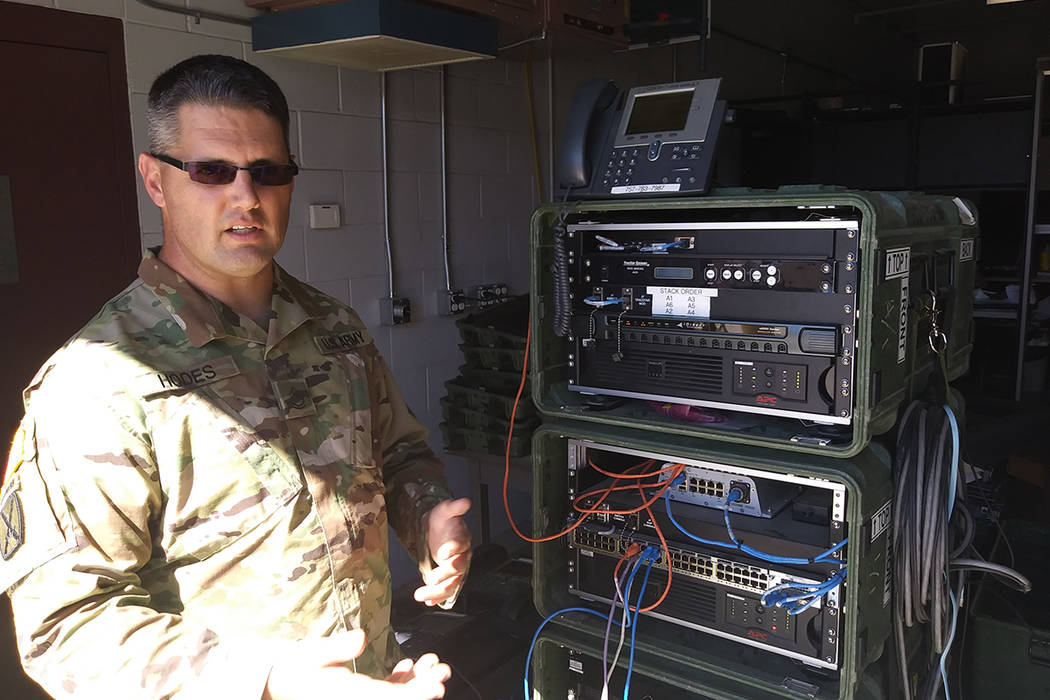 Sgt. 1st Class Ken Hodes of the Nevada Army National Guard talks Wednesday about communications equipment he will use on during a deployment to Puerto Rico. Six Nevada Army National Guard members  ...
