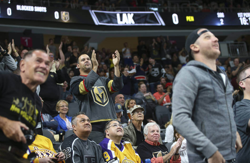 Golden Knights fans cheer after a goal against the Los Angeles Kings during an NHL preseason hockey game at T-Mobile Arena in Las Vegas on Tuesday, Sept. 26, 2017. The Kings won 3-2 in overtime. C ...