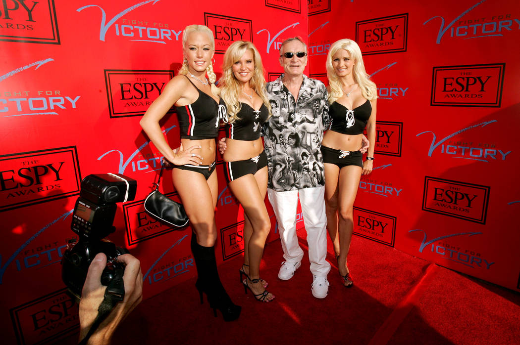 FILE PHOTO -  Playboy magazine founder Hugh Hefner (C) arrives with friends for an ESPY Awards pre-party at the Playboy Mansion in Beverly Hills, California in this July 12, 2005 file photo. REUTE ...