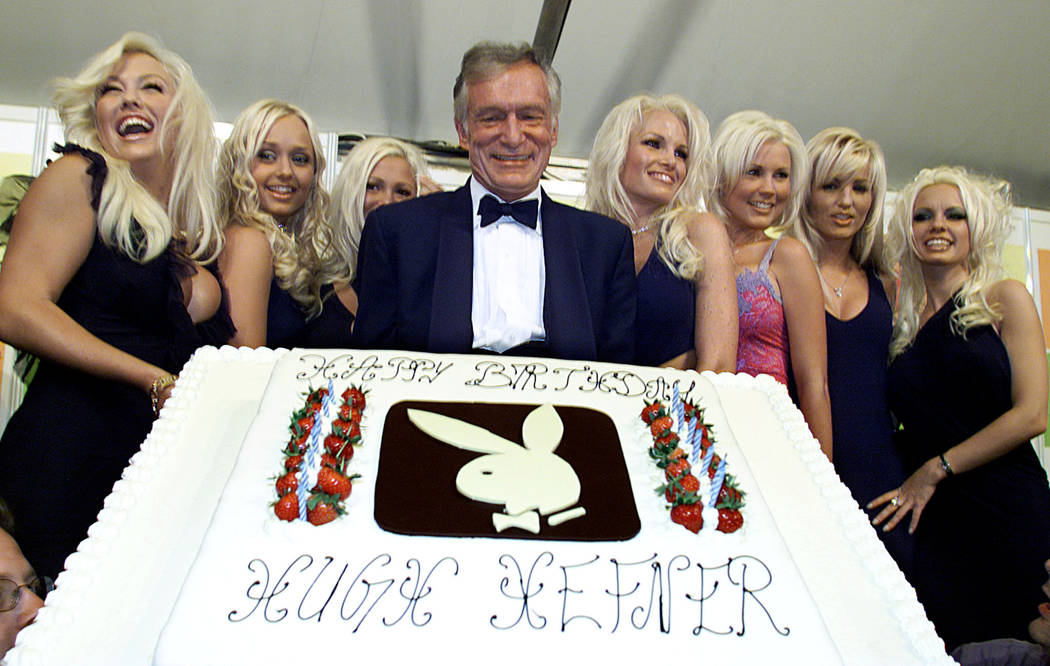 FILE PHOTO -  Hugh Hefner (C) Playboy founder and Editor-in-Chief, displays a giant birthday cake to celebrate his 75th birthday as seven playmates look on in Cannes May 12, 2001. REUTERS/File Photo