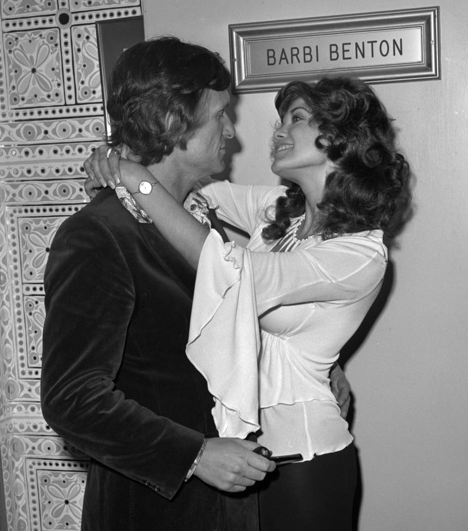 Barbi Benton and Hugh Hefner are seen May 15, 1975, in Las Vegas on the opening night of Marty Robbins' run at the Sahara. CREDIT: Las Vegas News Bureau
