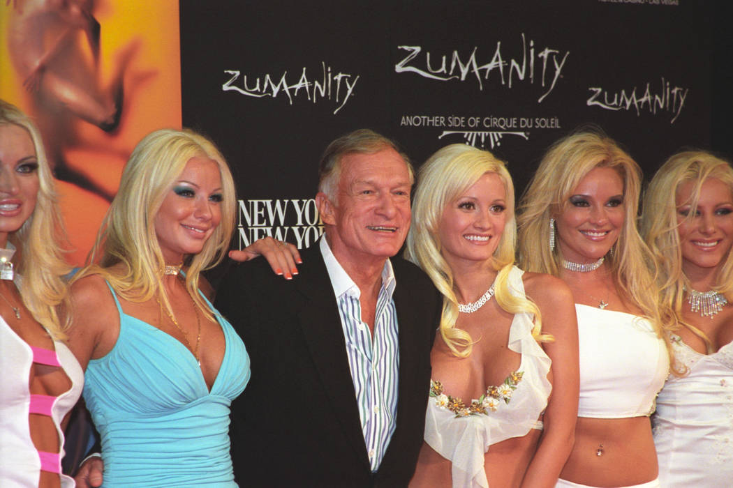 Hugh Hefner arrives with Playboy Playmates, including Holly Madison, for the gala premier of Humanity at New York New York in Las Vegas September 20, 2003. CREDIT: Bob Brye/Las Vegas News Bureau