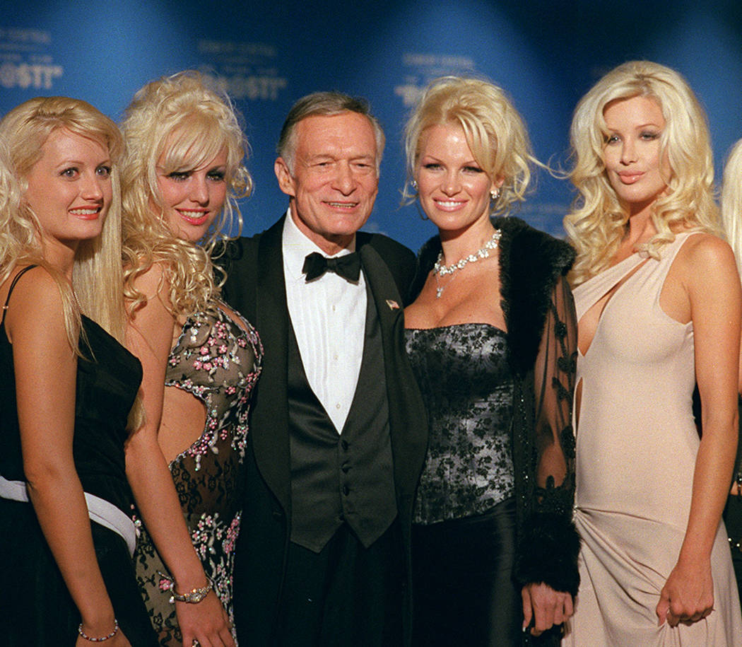 Hugh Hefner, 75, center, poses with four of his girlfriends before the start of The New York Friars Club Roast in New York, Sept. 29, 2001. The New York Friars, a members-only group of entertainer ...