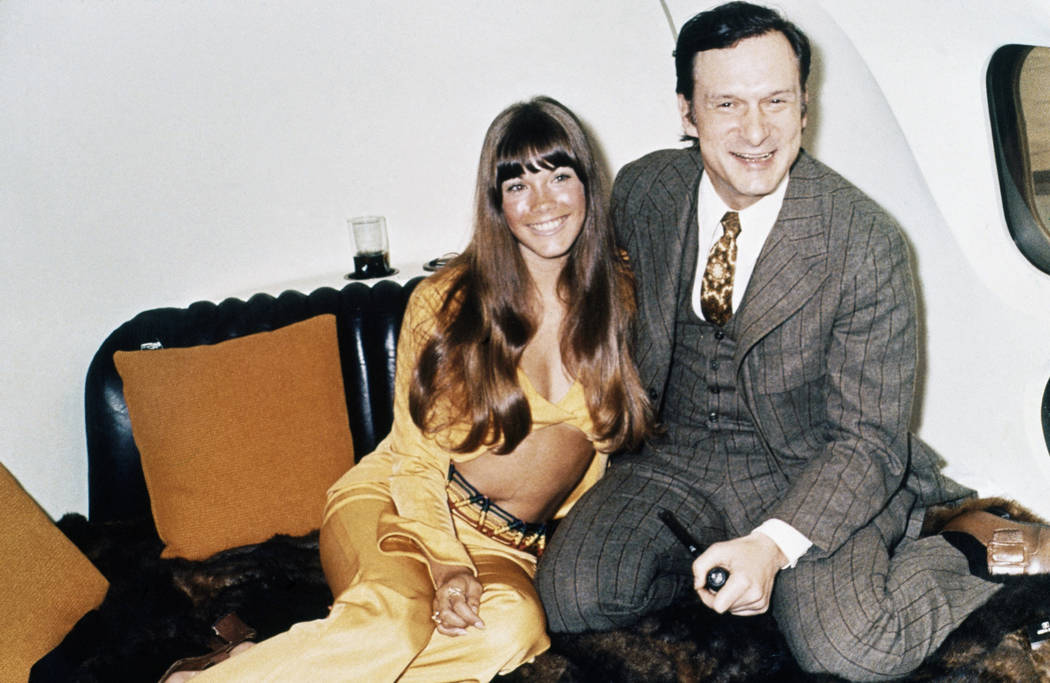 Playboy boss Hugh Hefner, right, poses with girlfriend Barbi Benton on a circular bed aboard his private jet a The Big Bunny, May, 1970. (AP Photo/Bob Dear)