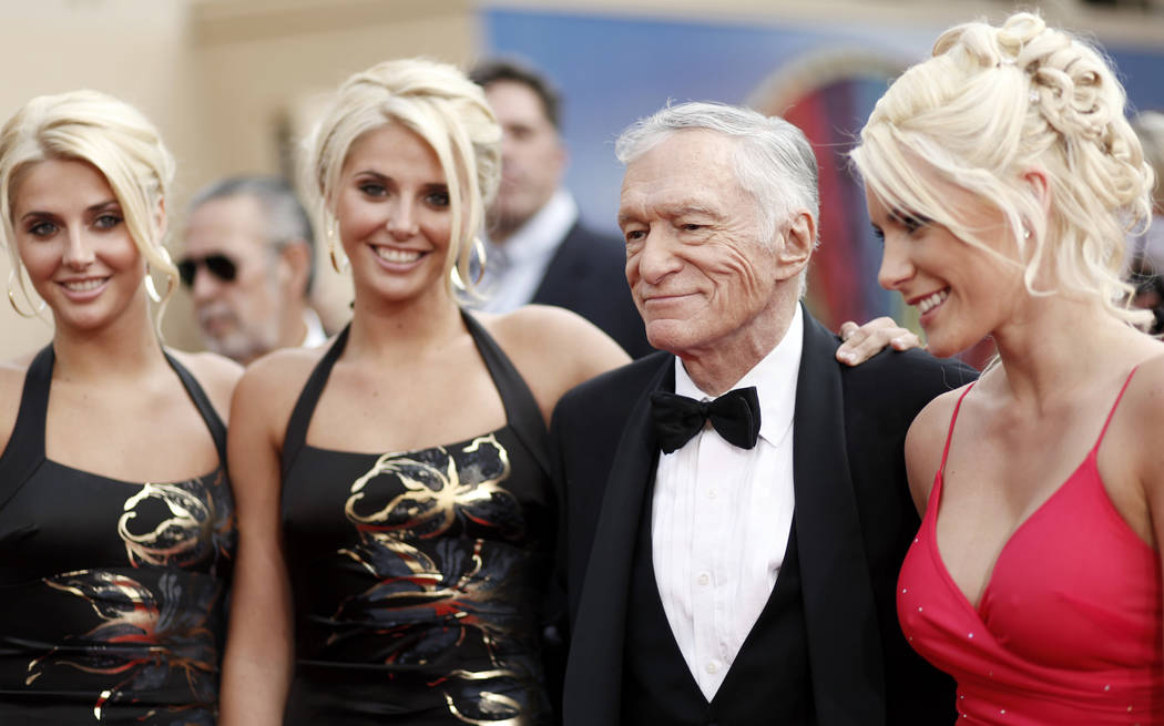 Identical twins Karissa and Kristina Shannon, Hugh Hefner, second from right, and Crystal Harris, right, arrive at the taping of the American Film Institute Life Achievement Awards honoring actor  ...