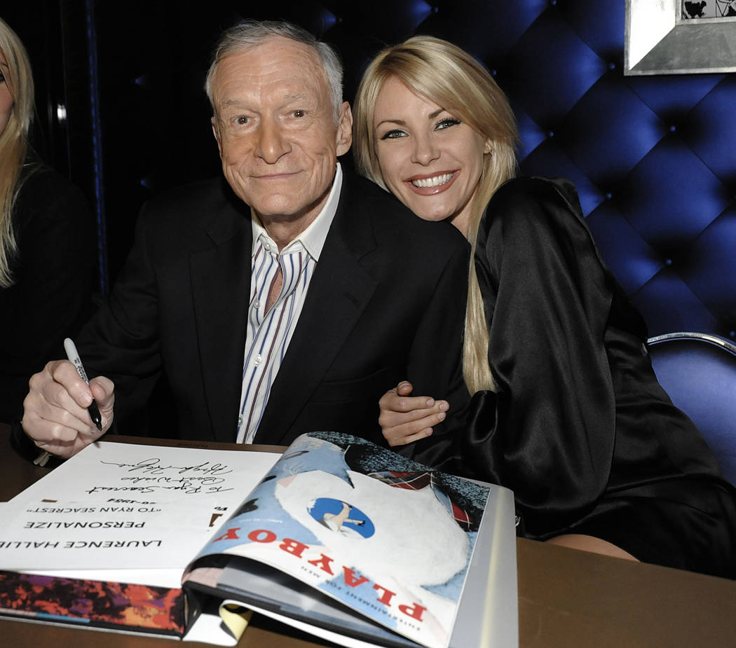 "Hugh Hefner, left, and model Crystal Harris at a party celebrating the release of the book ""Hugh Hefner's Playboy"" a limited edition anthology by Taschen in Beverly Hills, Calif. ..."