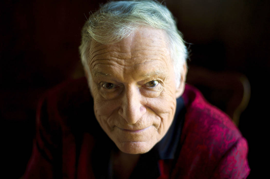 FILE - This Oct. 13, 2011 file photo shows  American magazine publisher, founder and Chief Creative Officer of Playboy Enterprises, Hugh Hefner at his home at the Playboy Mansion in Beverly Hills, ...
