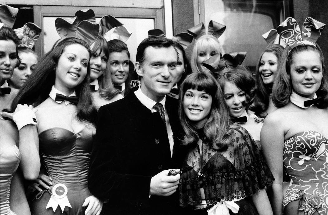 Hugh Hefner, publisher and owner of Playboy Magazine, and his girlfriend Barbara Benton, 19-year-old coed turned actress, are surrounded by Bunny Girls at the Playboy Club in London, on September  ...