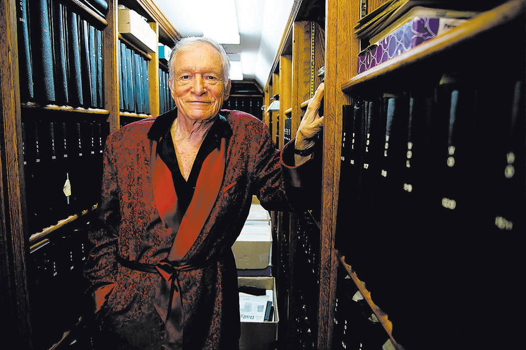 Hugh Hefner poses for a photograph at his home at the Playboy Mansion in Beverly Hills, Calif., in 2011.  (AP Photo/Kristian Dowling)