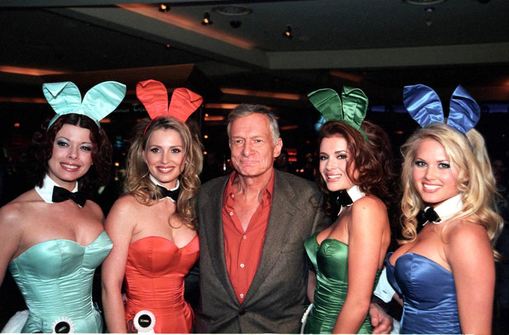 Hugh Hefner poses with Playboy bunnies March 1, 2001, at the Hard Rock Hotel in Las Vegas. CREDIT: Glenn Pinkerton/Las Vegas News Bureau