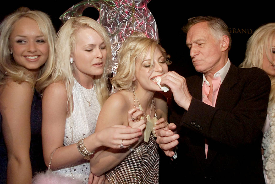 Playboy founder Hugh Hefner feeds a piece of cake to Cathi O'Malley as Kimberly Stanfield (L) and Katie Lohmann (2ndL) look on during Hefner's 75th birthday party at Studio 54 inside the MGM Grand ...