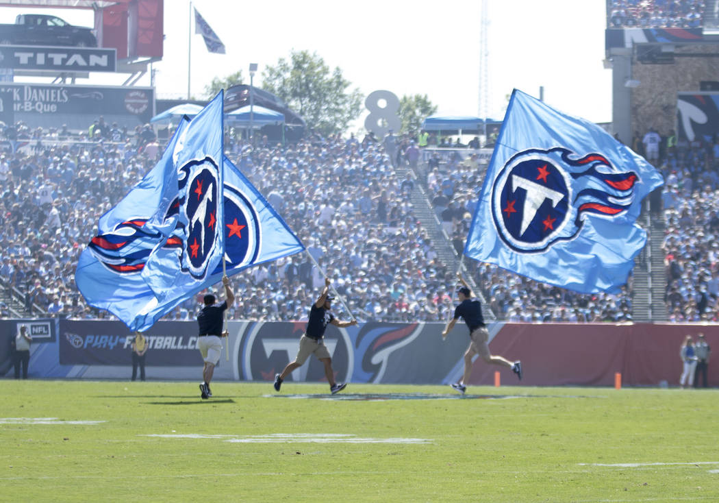 Tennessee Titans' flags go across the field after the team scored against the Oakland Raiders in the first half of their game at the Nissan Stadium in Nashville, Tenn., Sunday, Sept. 10, 2017. Hei ...