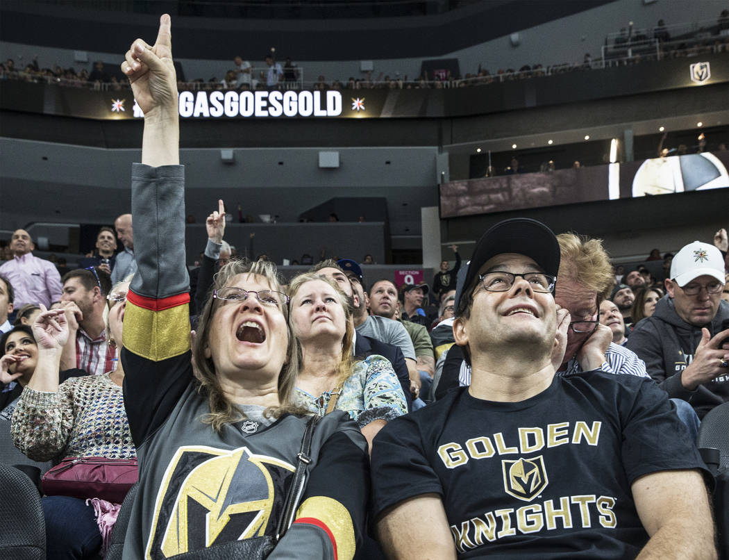 Caroline Furlong, left, and husband Mike cheer for the Vegas Golden Knights during their first home preseason game with the Los Angeles Kings on Wednesday, Sept. 26, 2017, at T-Mobile Arena, in La ...