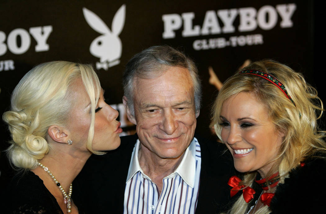 FILE PHOTO -  Playboy magazine founder Hugh Hefner arrives with girlfriend Kendra Wilkinson (L) and Bridget Marquardt for his 80th birthday party in Munich's famous club P1 May 31, 2006. REUTERS/M ...