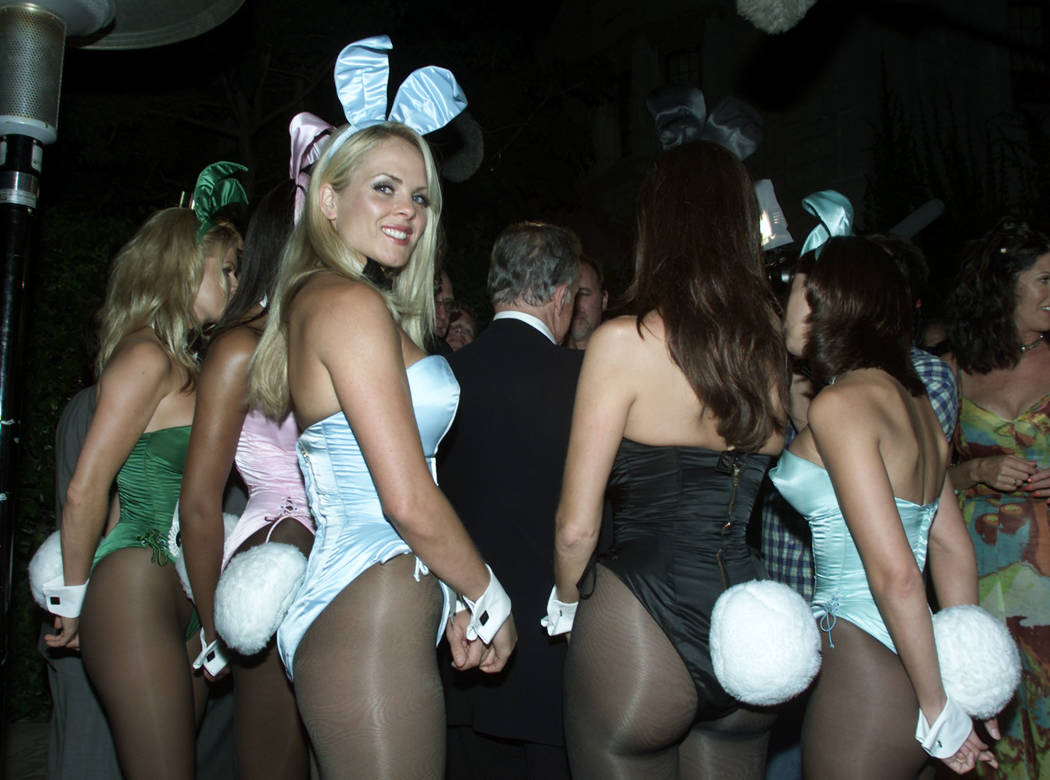 Hugh Hefner surrounded by Playboy Bunnies as he is interviewed by television crews, August  2000.  REUTERS/Files