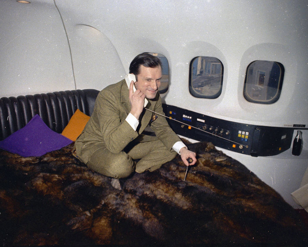 Playboy magazine publisher Hugh Hefner is shown aboard his private plane, 1970.  (AP Photo)