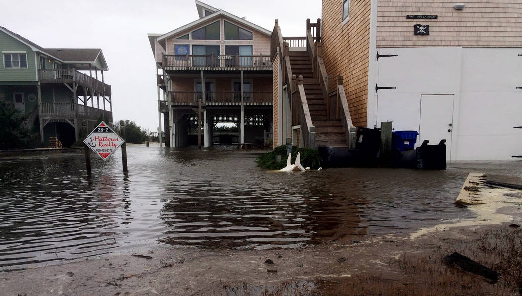 Floodwaters surround homes as Hurricane Maria moves closer to North Carolina's Outer Banks on Tuesday, Sept. 26, 2017. Thousands of visitors abandoned their vacation plans and left the area as the ...