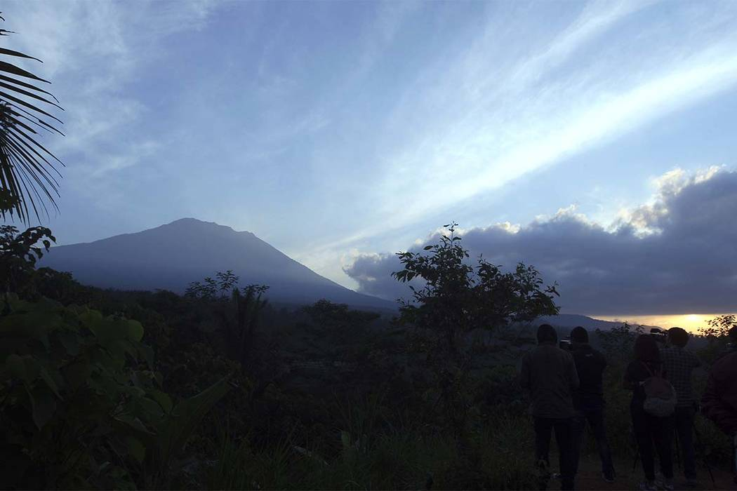 Mount Agung is seen at sunrise from an observation point which is about 12 kilometer (7.4 miles) away from the volcano in Karangasem, Bali, Indonesia, Thursday, Sept. 28, 2017. The exodus from the ...