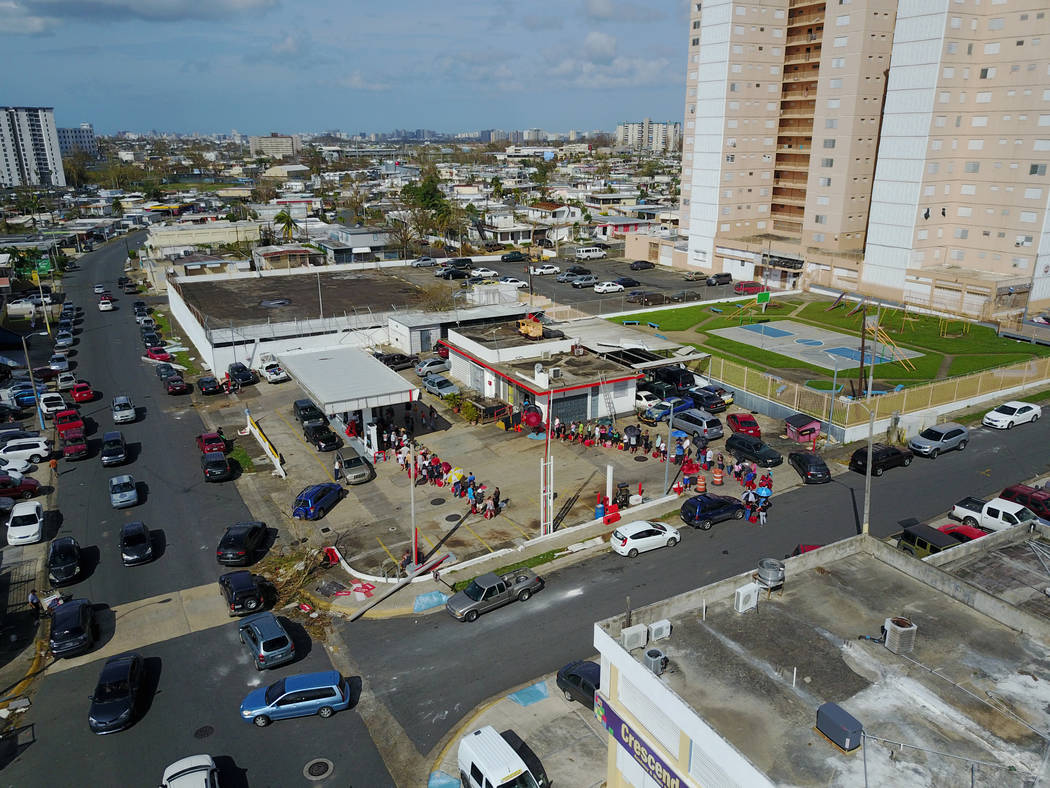 An aerial photo shows people lining up at a gas station follwing damages caused by Hurricane Maria in San Juan, Puerto Rico, Sept. 27, 2017. (DroneBase/Reuters)