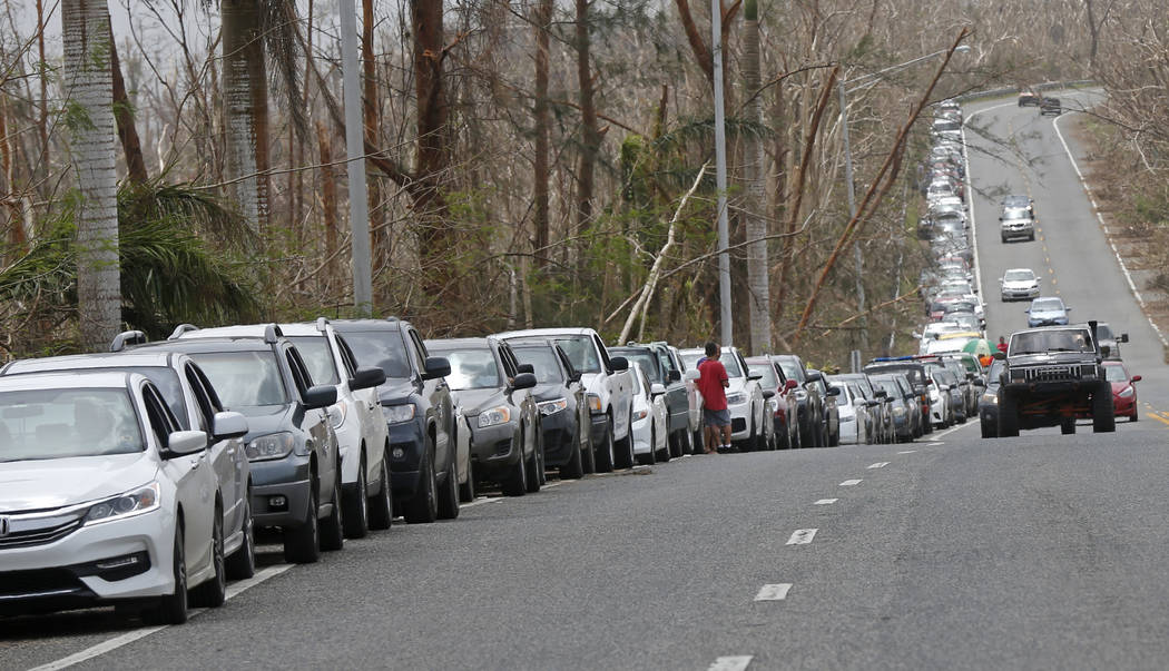 Cars are queued up as people wait to buy gas in the aftermath of Hurricane Maria, in Morovis, Puerto Rico, Wednesday, Sept. 27, 2017. A week since the passing of Maria many are still waiting for h ...