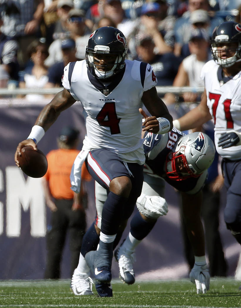 Houston Texans quarterback Deshaun Watson (4) scrambles away from New England Patriots defensive end Trey Flowers (98) during the first half of an NFL football game, Sunday, Sept. 24, 2017, in Fox ...