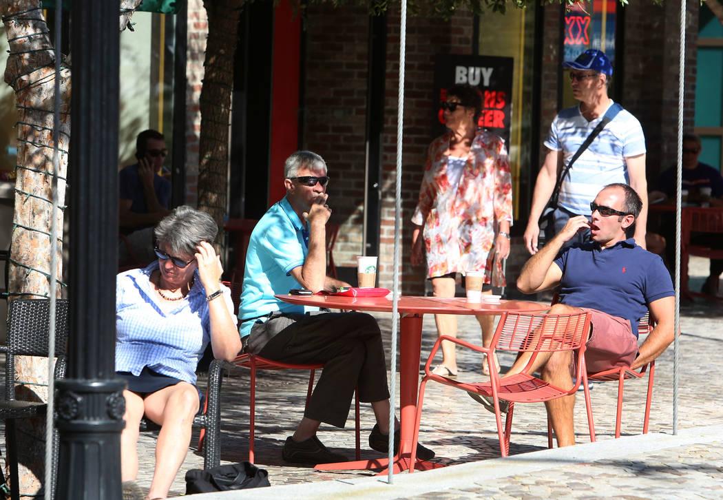 Tourists enjoy the morning sun at The Park near T-Mobile Arena on Thursday, Sept. 28, 2017, in Las Vegas. Bizuayehu Tesfaye Las Vegas Review-Journal @bizutesfaye