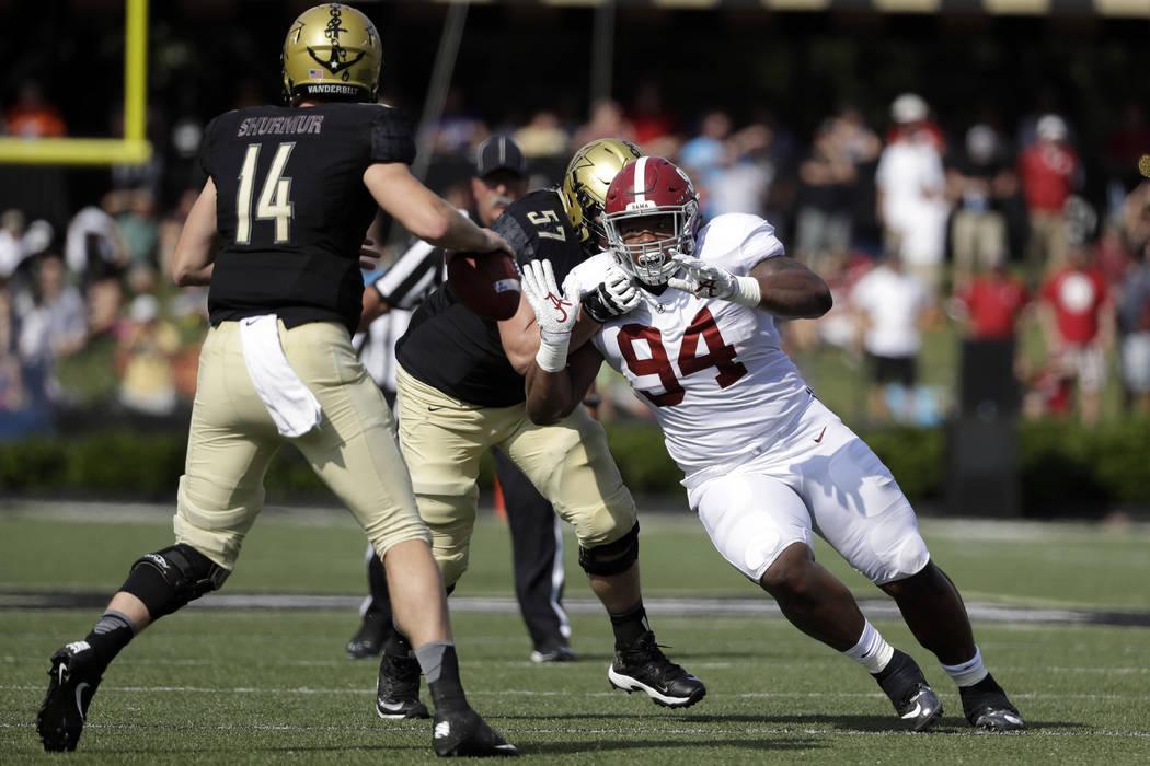 Alabama defensive lineman Da'Ron Payne (94) pressures Vanderbilt quarterback Kyle Shurmur (14) in the first half of an NCAA college football game Saturday, Sept. 23, 2017, in Nashville, Tenn. (AP  ...