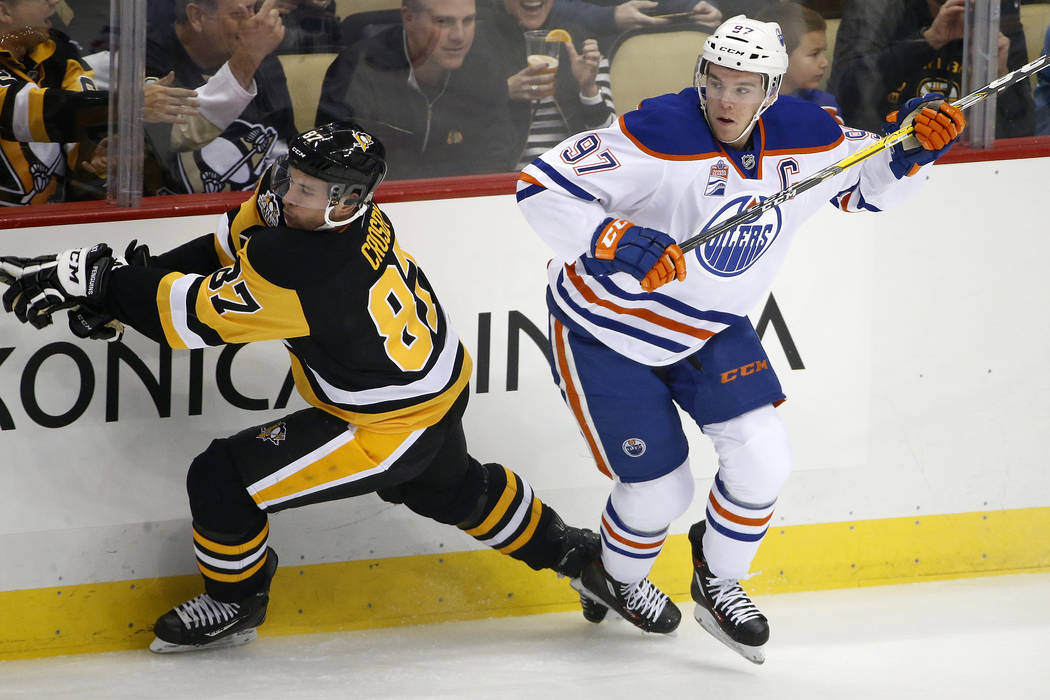 Edmonton Oilers' Connor McDavid (97) and Pittsburgh Penguins' Sidney Crosby (87) collide during the first period of an NHL hockey game in Pittsburgh, Tuesday, Nov. 8, 2016. (AP Photo/Gene J. Puskar)