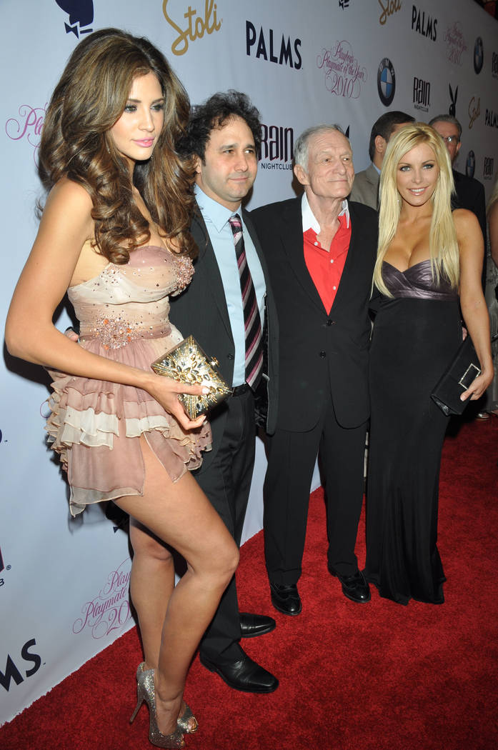 Hope Dworaczyk, George Maloof, Hugh Hefner and Dasha Astafieva pose on arrival at Playboy magazine's 2010 Playmate of the Year announcement and celebration at the Palms Casino Resort in Las Vegas  ...