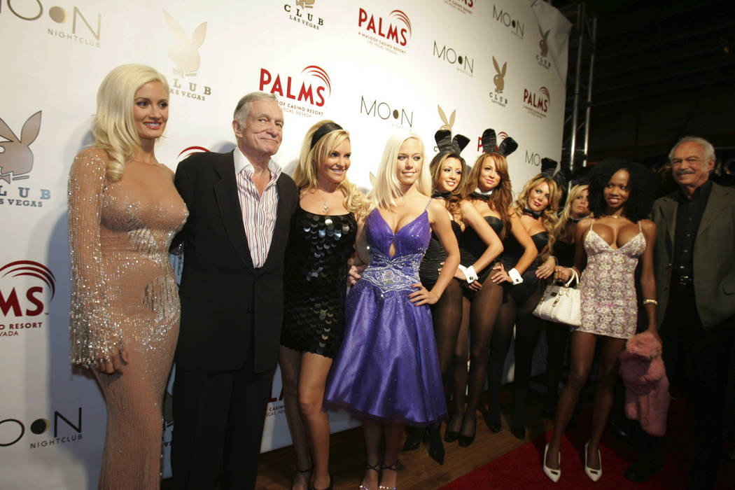Holly Madison, Hugh Hefner, Bridget Marquardt, Kendra Wilkinson, playboy bunnies, Nahtasha Budhi and Keith Hefner pose on the red carpet for the opening event held for the Playboy Club at the Palm ...