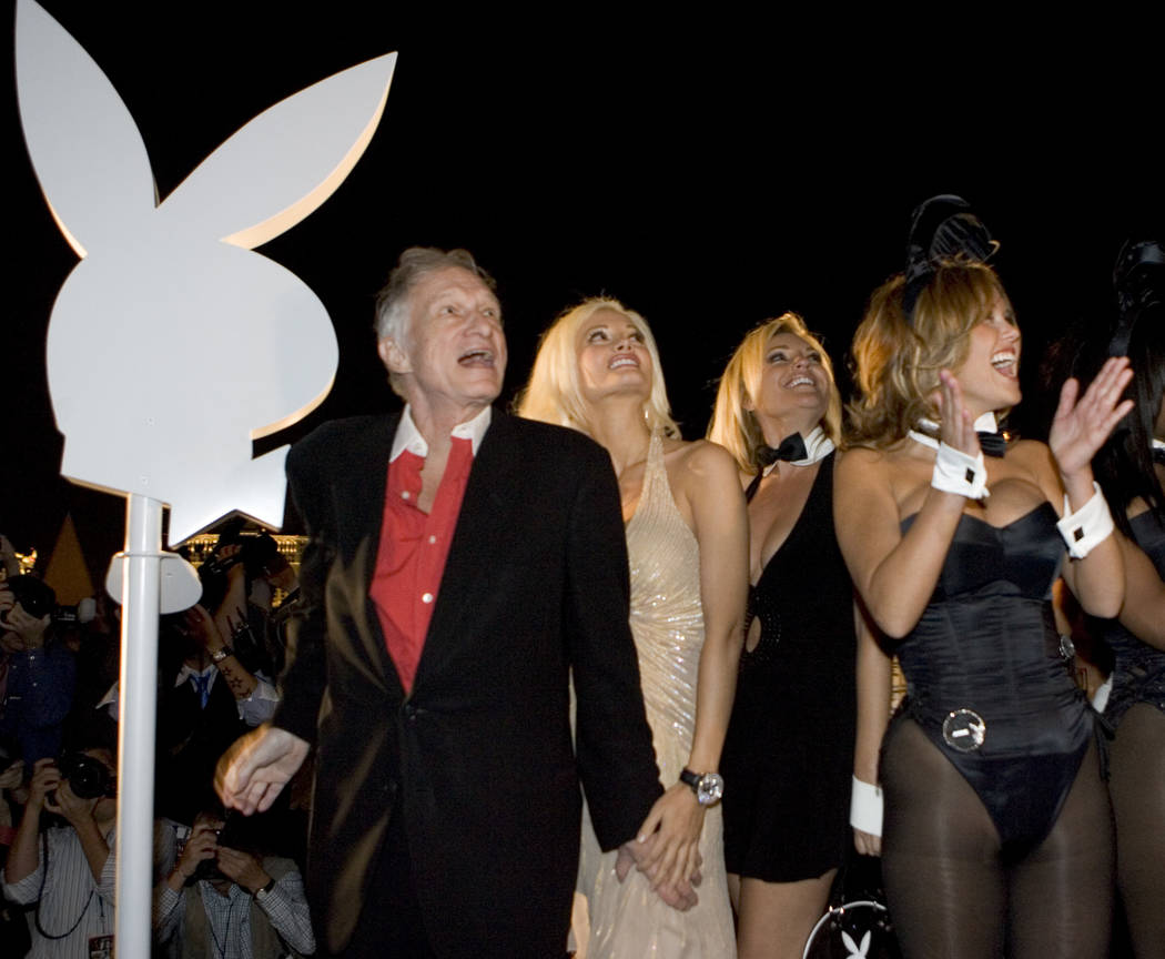 Playboy founder Hugh Hefner cheers the lighting of the Playboy logo at the opening of the Playboy Club atop the new Fantasy Tower at the Palms casino resort Oct. 6, 2006. The first Playboy Club in ...