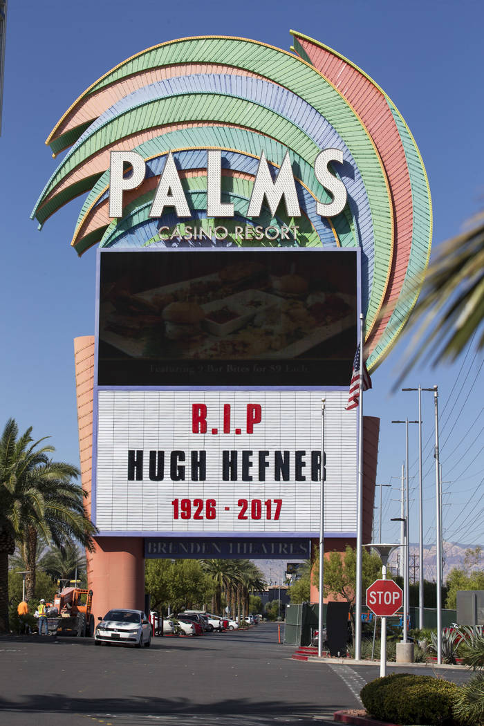 The Palms hotel-casino marquee memorializes Playboy Magazine founder Hugh Hefner on Thursday, Sept. 28, 2017, in Las Vegas. Hefner died of natural causes at his home on Wednesday at the age of 91. ...