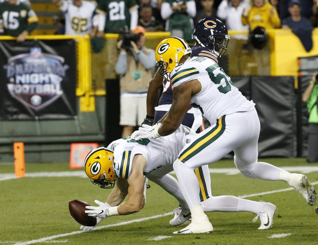 Green Bay Packers' Jake Ryan recovers a fumble during the first half of an NFL football game against the Chicago Bears Thursday, Sept. 28, 2017, in Green Bay, Wis. (AP Photo/Mike Roemer)
