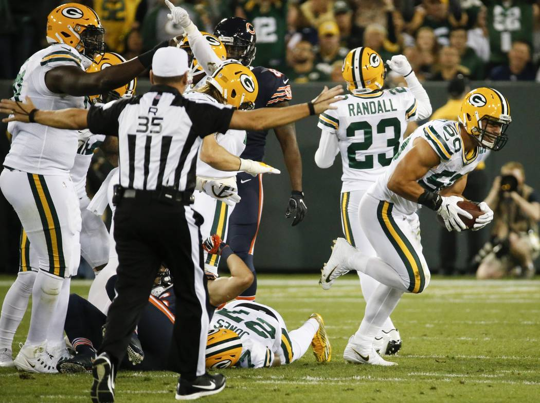 Green Bay Packers' Blake Martinez celebrates after recovering a fumble during the first half of an NFL football game against the Chicago Bears Thursday, Sept. 28, 2017, in Green Bay, Wis. (AP Phot ...