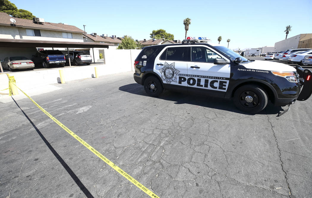 Metropolitan Police Department cordon off the scene as they investigate an officer-involved shooting that occurred in a strip mall near Jones Boulevard and U.S. Highway 95 on Thursday, Sept. 27, 2 ...