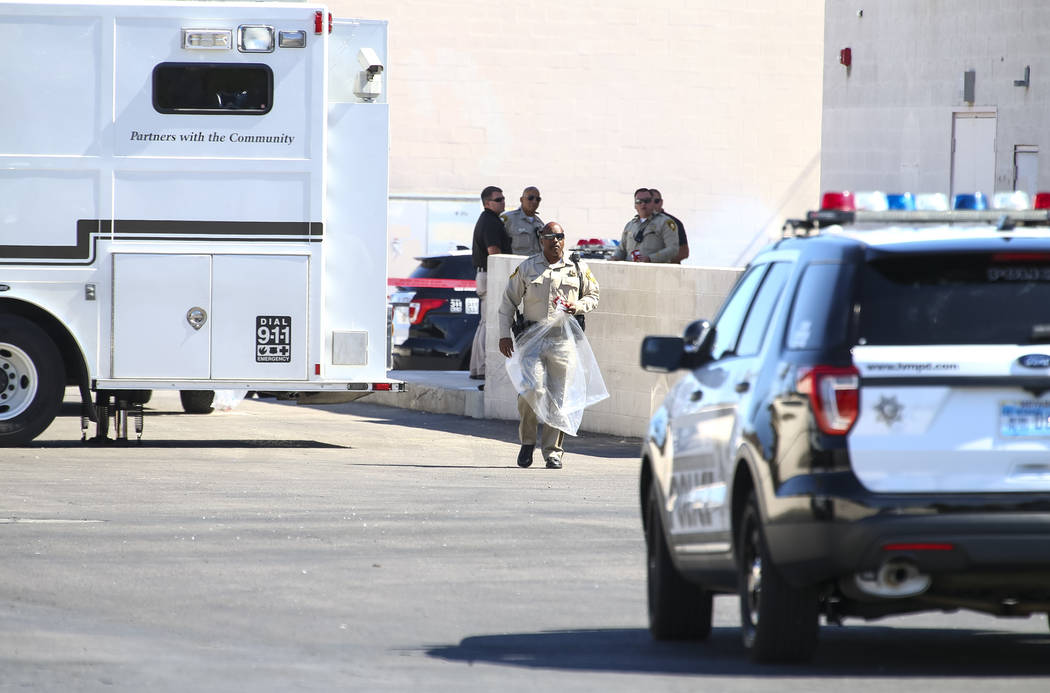Metropolitan Police Department investigate an officer-involved shooting that occurred in a strip mall near Jones Boulevard and U.S. Highway 95 on Thursday, Sept. 27, 2017, in Las Vegas. Richard Br ...