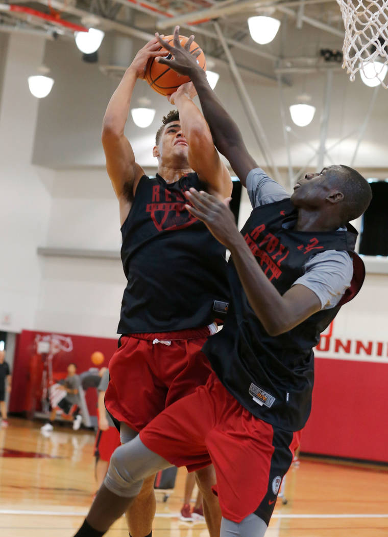 UNLV basketball player Jay Green, left, tries to shoot over his teammate Cheikh Mbacke Diong during their practice at the Mendenhall Center in Las Vegas, Saturday, Sept. 30, 2017. Chitose Suzuki L ...