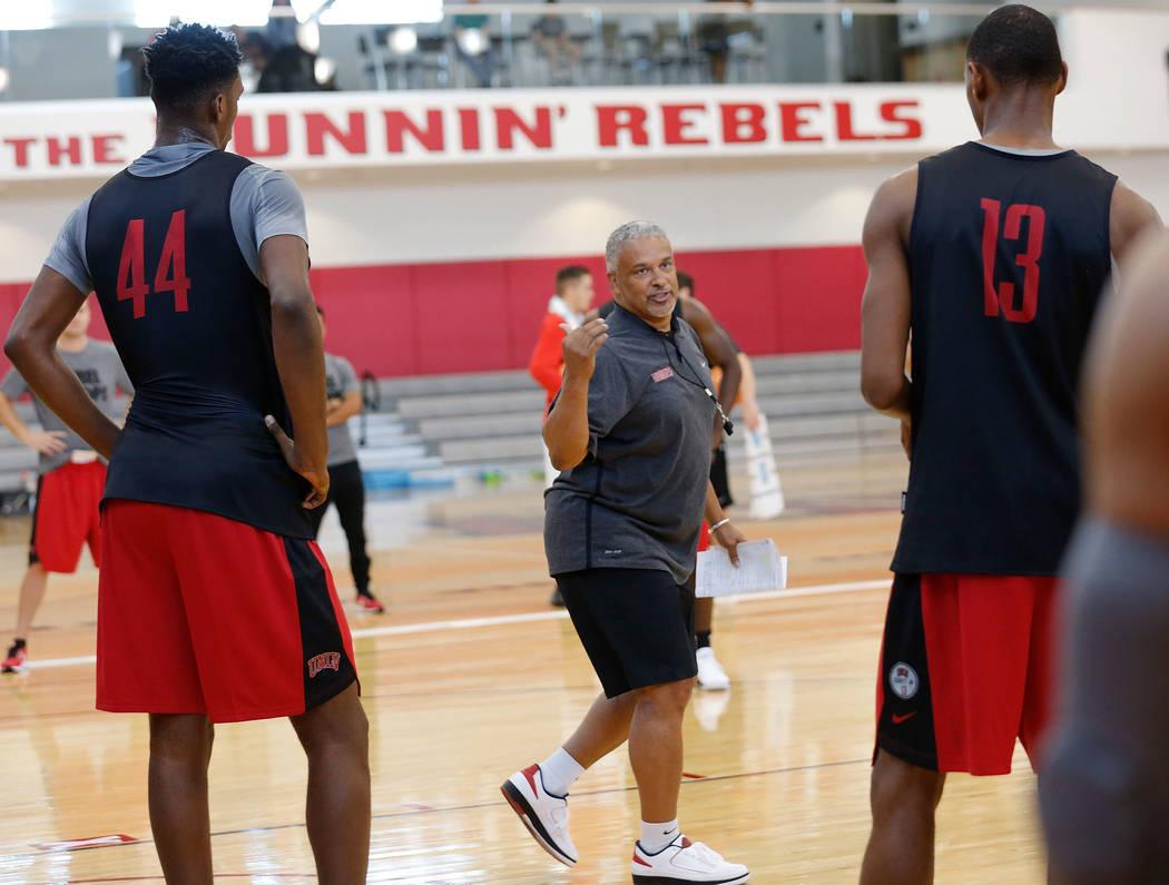 UNLV men's basketball head coach Marvin Menzies, center, talks during their practice at the Mendenhall Center in Las Vegas, Saturday, Sept. 30, 2017,  as Brandon McCoy (44) and Ben Coupet Jr. (13) ...