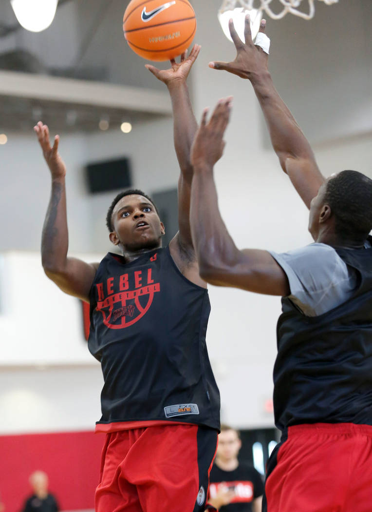 UNLV basketball player Amauri Hardy, left, shoots over his teammate Cheickna Dembele during their practice at the Mendenhall Center in Las Vegas, Saturday, Sept. 30, 2017. Chitose Suzuki Las Vegas ...