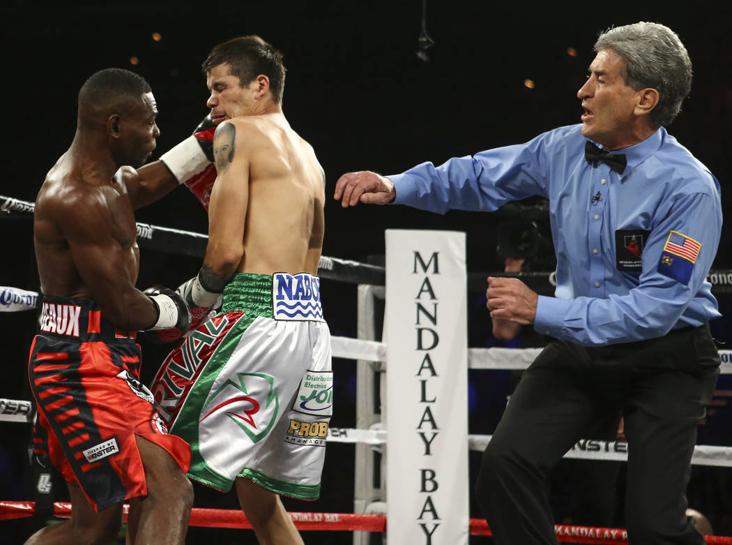 Guillermo Rigondeaux delivers the knockout punch against Moises Flores in their super bantamweight title fight at the Mandalay Bay Events Center in Las Vegas on Saturday, June 17, 2017. Rigondeaux ...