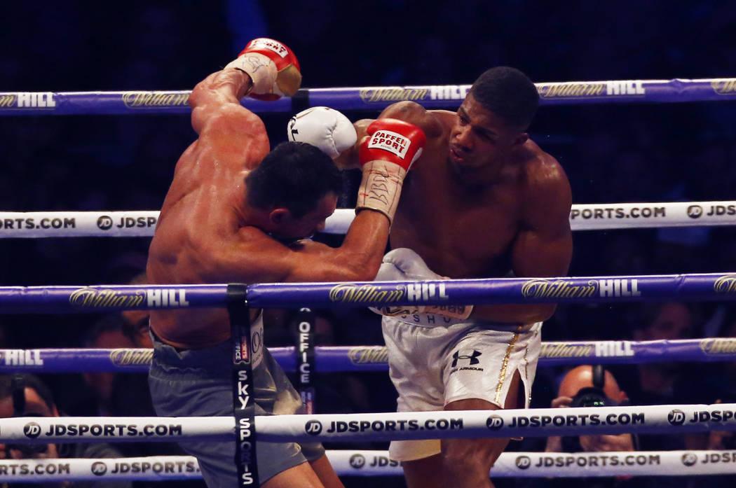 Britain Boxing - Anthony Joshua, right, v Wladimir Klitschko IBF, IBO & WBA Super World Heavyweight Title's - Wembley Stadium, London, England - 29/4/17 Anthony Joshua in action with Wladimir  ...