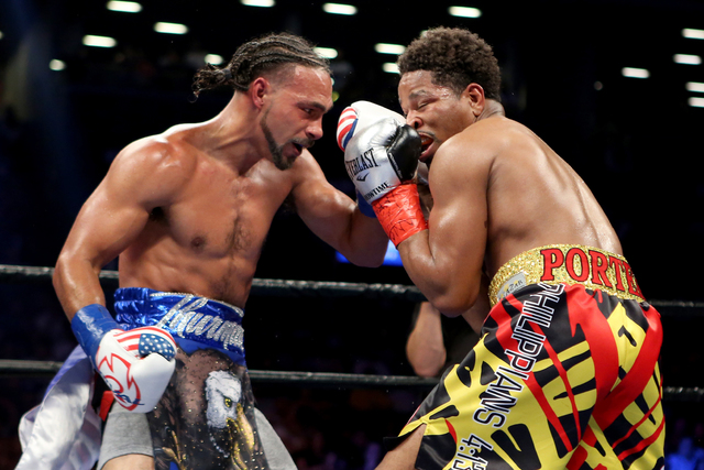 Keith Thurman, left, lands an uppercut against Shawn Porter during their WBA Welterweight title fight at the Barclays Center in Brooklyn borough of New York on Saturday, June 25, 2016. Thurman won ...