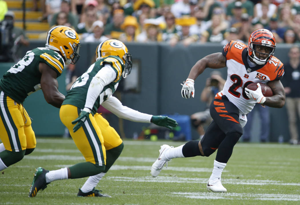 FILE - In this Sunday, Sept. 24, 2017, file photo, Cincinnati Bengals' Joe Mixon runs during the first half of an NFL football game against the Green Bay Packers in Green Bay, Wis. Mixon became th ...
