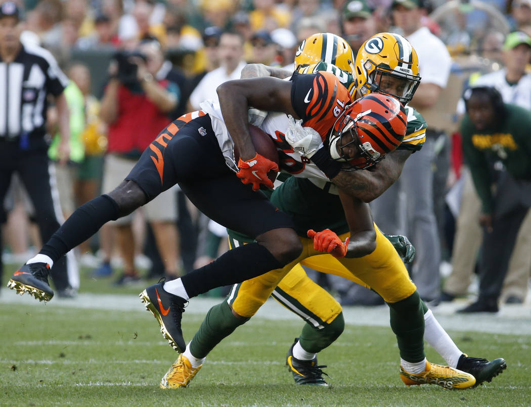FILE - In this Sunday, Sept. 24, 2017, file photo, Cincinnati Bengals' A.J. Green is tackled by Green Bay Packers' Josh Jones during the first half of an NFL football game in Green Bay, Wis. Joe M ...