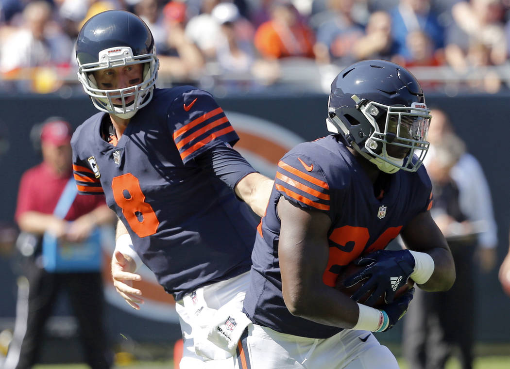 FILE - In this Sunday, Sept. 24, 2017, file photo, Chicago Bears quarterback Mike Glennon (8) hands off to running back Jordan Howard (24) during the first half of an NFL football game against the ...