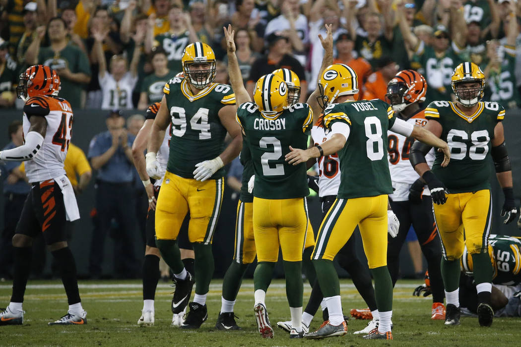 Green Bay Packers' Mason Crosby celebrates his game-winning field goal during overtime of an NFL football game against the Cincinnati Bengals Sunday, Sept. 24, 2017, in Green Bay, Wis. The Packers ...