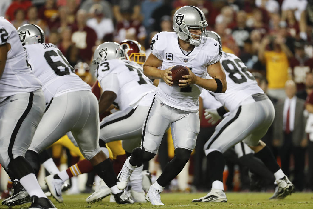 Oakland Raiders quarterback Derek Carr (4) turns out of the pocket during the first half of an NFL football game against the Washington Redskins in Landover, Md., Sunday, Sept. 24, 2017. (AP Photo ...