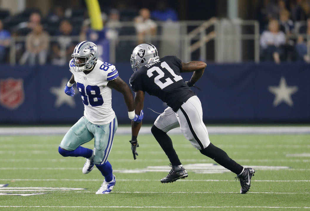 Dallas Cowboys wide receiver Dez Bryant (88) and Oakland Raiders cornerback Sean Smith (21) face off during a preseason NFL football game, Saturday, Aug. 26, 2017, in Arlington, Texas. (AP Photo/R ...