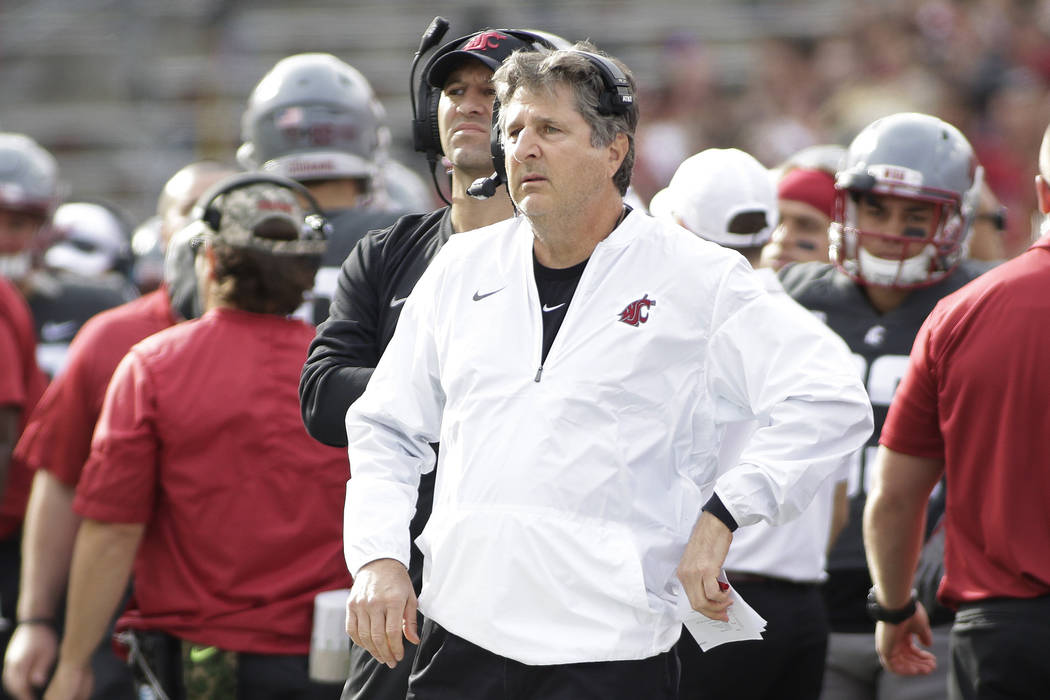 Washington State head coach Mike Leach, center, looks on during the first half of an NCAA college football game against Oregon State in Pullman, Wash., Saturday, Sept. 16, 2017. (AP Photo/Young Kwak)